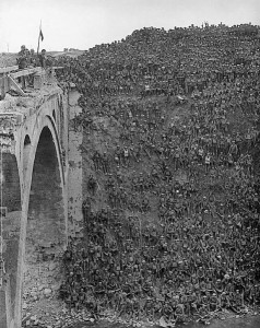 Men of the 137th Brigade, 46th Division, being addressed by Brigadier General J C Campbell VC CMG DSO on the Riqueval Bridge over the St Quentin Canal, which formed part of the German's Hindenburg Line, broken on 29 September 1918.